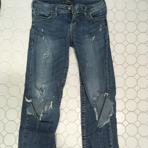 Destroyed women's silver Capri jeans